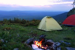 The camping with tents and bonfire. Royalty Free Stock Photos
