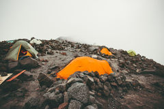 Camping tents in foggy Mountains Royalty Free Stock Image