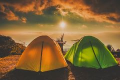 Camping and tents On high ground with sunrise sunset Stock Photography