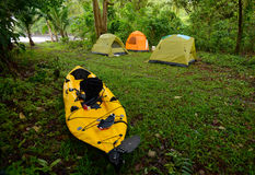 Camping with tents and a kayak near an ocean in panama Stock Photo