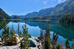 Camping tents by lake in Cascade Mountains. Royalty Free Stock Image
