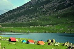 Camping tents at the Nundkol lake in Sonamarg, Kashmir, India. Camping tents at the Nundkol lake which is near the Gangabal lake, at the base of Mount Harmukh stock images