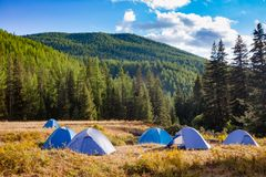 Wild camping in Altai Mountains Mongolia. Camping tents on a river shore in wild camping, Altai Mountains, Western Mongolia Royalty Free Stock Photography