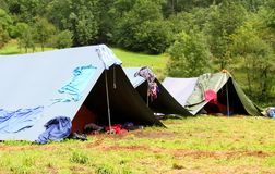 Camping tents in a scout camp and drying laundry out Royalty Free Stock Photos