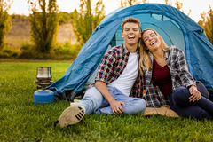 Camping time. Shot of a happy couple camping on the nature Stock Photos