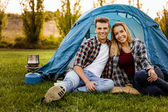 Camping time. Shot of a happy couple camping on the nature Royalty Free Stock Image