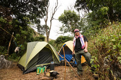 Camping tourist in forest mountain peak Royalty Free Stock Photography