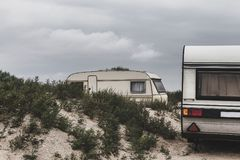 Caravan Camping Car Travels On The Beach. Resting Tourism Vacation Concept. Camping Trailer On The Beach. Resting Tourism Vacation Concept Royalty Free Stock Images