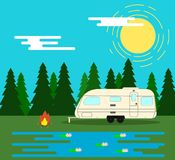 Camping Trailer with Camp Fire in the Forest by the Lake Outdoors. Resting in the nature and summer holidays concept Stock Photography