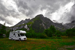 Camping Trailer. Car in Swiss Alps Switzerland -La Fouly royalty free stock photo