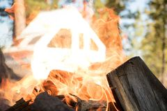 Camping trailer through the flames of a fire royalty free stock photos