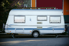 Camping trailer. A white modern residential and camping trailer made of sheet metal stands in a parking lot royalty free stock photography