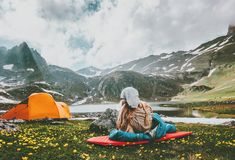 Camping travel in mountains vacations woman relaxing. In sleeping bag on mat enjoying landscape Lifestyle concept adventure outdoor Royalty Free Stock Image