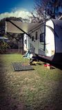 Camping travel trailer. RV travel trailer on the river camper camping Stock Images