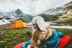 Camping traveling woman relaxing outdoor in sleeping bag on mat. Enjoying mountains landscape Lifestyle concept adventure weekend royalty free stock images