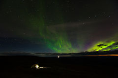Camping Under Aurora Borealis Near Alaska-Yukon Border Crossing Royalty Free Stock Photos
