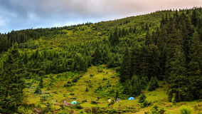 Camping under hill at Carpathian mountains, summertime journey. Camping under hill at Carpathian mountains, summertime journey Royalty Free Stock Photos