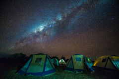 Camping under the milky way. The Milky Way over the viewing field and camping tents at Ngorongoro crater, Tanzania.  Long exposure and ISO3200 image Stock Images