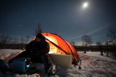 Camping under the moon Stock Photo