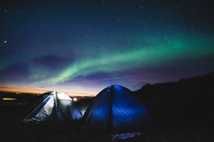 Camping under the northern lights Royalty Free Stock Images
