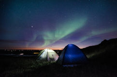 Camping under the northern lights Stock Photos