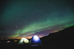 Camping under the northern lights Stock Photography