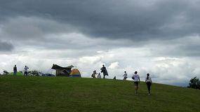 Camping under rain clouds Stock Image