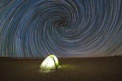 Camping under Spiral Vortex Star Trails. Stock Photos
