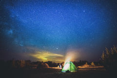 Camping under star sky Stock Photography