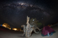 Camping under starry sky and Milky Way arc, with details of its colorful core, outstandingly bright, captured in Southern Africa. Royalty Free Stock Photos
