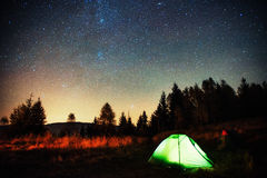 Camping under the stars. Green solo tent dark night sky Royalty Free Stock Photography