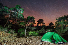 Camping under the stars. Green solo tent dark night sky Stock Photos