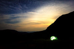 Camping under stars in mountains Royalty Free Stock Image