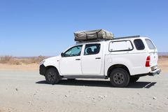 Camping Toyota Hilix 4WD roof tent desert, Namibia Stock Photo