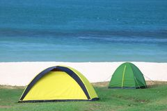 Camping on the white sand beach with ocean background Stock Images