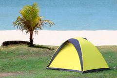 Camping on the white sand beach with ocean background Stock Photos