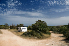 Camping in the wild. A solitary camping van on top of the hill royalty free stock photos