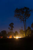 Camping in the wild. Tent fire camping on hill in the bold night at kaeng krachan national park thailand Royalty Free Stock Image