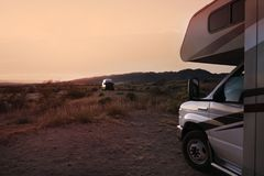 Camping in wilderness with motorhome. Camping in wilderness with recreational vehicle at sunset, California, USA royalty free stock images