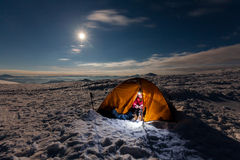 Camping during winter hiking in Carpathian mountains.  Royalty Free Stock Photo