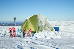 Camping during winter hiking in Carpathian mountains. A tent is set up in a high mountain environment Stock Photography