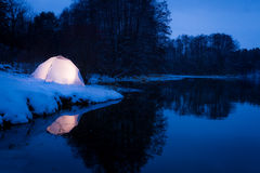 Camping in the winter at the lake. By night royalty free stock images