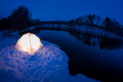 Camping in the winter at the lake Stock Photography