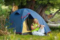 Camping woman Stock Photography