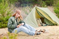 Camping woman tent nature cut sausage Stock Photos