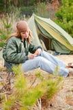 Camping woman tent nature cut sausage Royalty Free Stock Photo