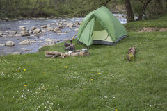 Camping in the woods on the banks of the river. Stock Photography