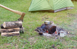 Camping in the woods on the banks Royalty Free Stock Photo