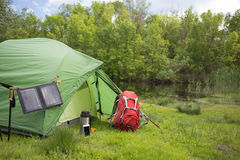 Camping in the woods on the banks of the river. Royalty Free Stock Image