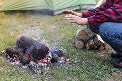 Camping in the woods with a fire in the wood Stock Photos